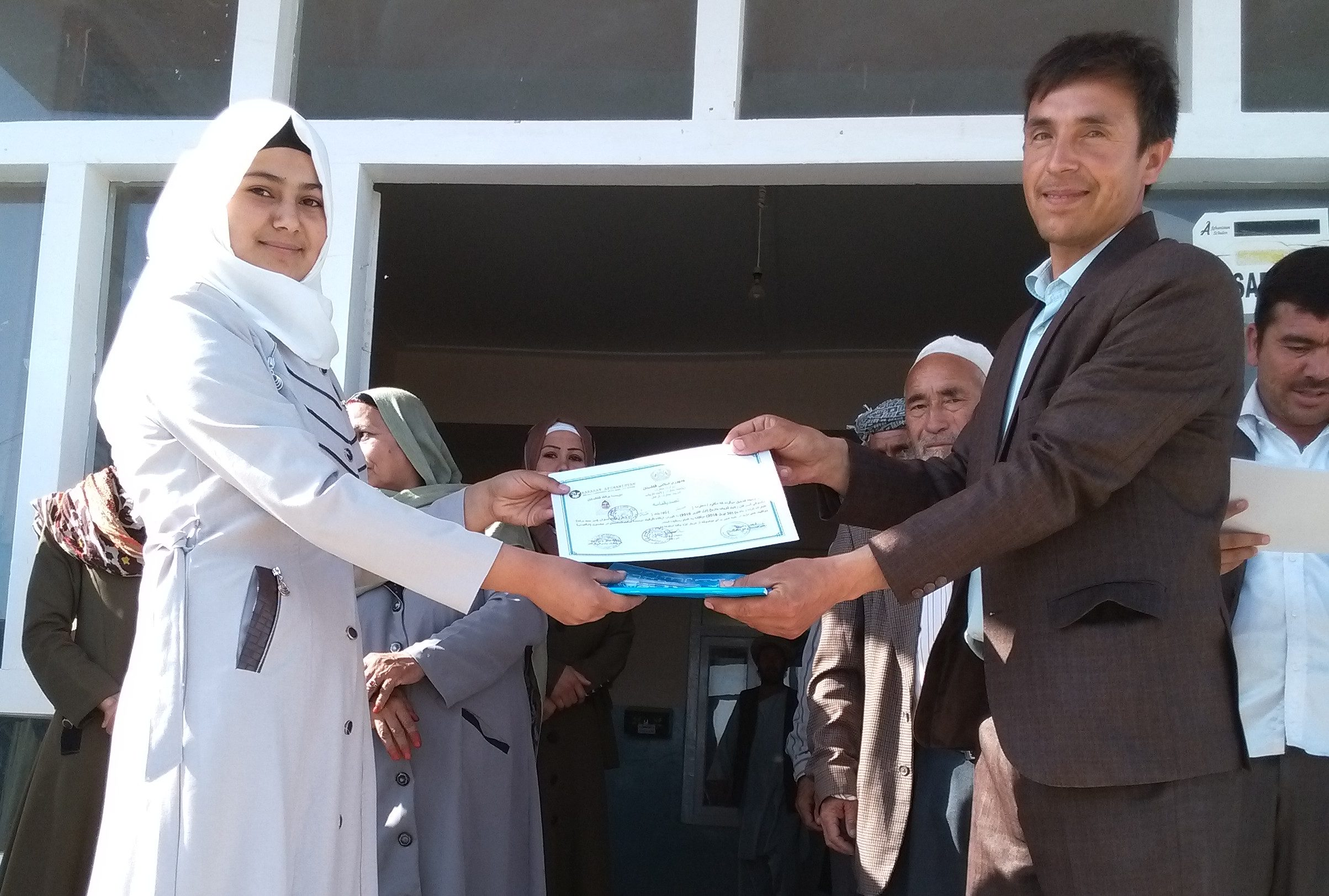 Photo of a young woman graduating from our high school program
